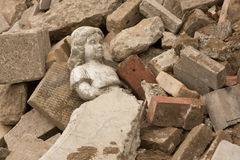 Statue laying in rubble Royalty Free Stock Images
