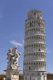 Statue and leaning Tower of Pisa Stock Photo