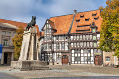 Statue of Leon and half-timbered building in Braunschweig Royalty Free Stock Photography