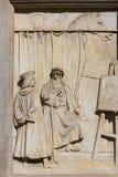 Statue of Leonardo da Vinci at Piazza della Scala, Milan, Italy. Statue of Leonardo da Vinci at Piazza della Scala, details of plinth, Milan, Italy royalty free stock images