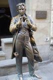 Statue of Leopold von Sacher-Masoch in Lviv, Ukraine. Statue of Leopold von Sacher-Masoch, an Austrian erotica writer and journalist in Lviv, Ukraine in front of Royalty Free Stock Photo