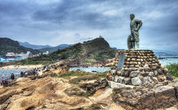 Statue of Lian Tianzhen at Yehliu Geological Park, Taiwan. A statue dedicated to Lian Tian Zhen, a local fisherman who, on March 18, 1964,  jumped into the sea Stock Images