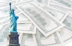 Statue of liberty on 100 us dollars background. Statue of liberty on 100 us dollars banknotes background Royalty Free Stock Images