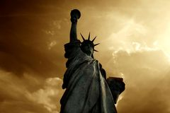 Statue of liberty. At the sunset stock photography