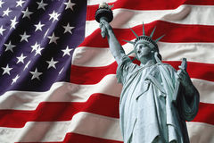 Statue of liberty. On american flag background Royalty Free Stock Image