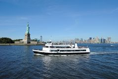 Statue of Liberty. A Ferry heading towards the Statue of Liberty on Liberty Island Royalty Free Stock Images