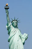 Statue of Liberty. Against the blue sky Stock Photos