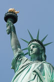 Statue of Liberty. Against the blue sky Royalty Free Stock Photos