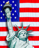 Statue of Liberty. Against flag royalty free stock image