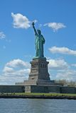 Statue of Liberty. Under a beautiful clear blue sky Royalty Free Stock Photo