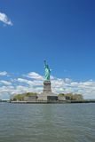 Statue of Liberty. Under the beautiful clear blue sky Royalty Free Stock Images