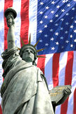 Statue of liberty. With the usa flag background Royalty Free Stock Photo