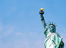 Statue of Liberty. Fragment over blue sky Stock Photography