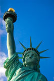 Statue of Liberty against Blue Sky Stock Image