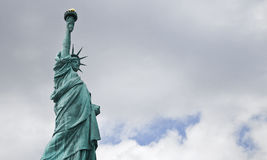 The Statue of Liberty Against a Cloudy Sky Royalty Free Stock Images