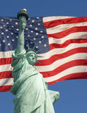Statue of Liberty and American flag Royalty Free Stock Photos