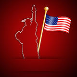 Statue of Liberty with American flag Royalty Free Stock Photo