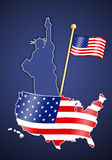 Statue of Liberty with American flag Stock Images