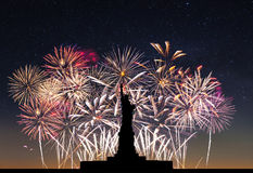Statue of Liberty on the background of fireworks Royalty Free Stock Photography