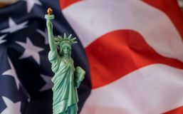 Statue of Liberty in the background of flag US. A, independence, day, freedom, america, symbol, american, patriotism, national, united, stripes, states royalty free stock image