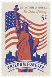 Statue of Liberty in background of nyc and flag. Postage stamp with statue of Liberty in background of american flag and New York skyscrapers and the word Stock Photo