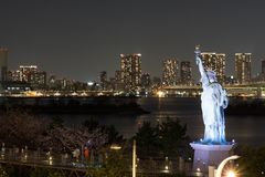 Statue of Liberty in the bay of Odaiba in night royalty free stock image