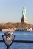 The Statue of Liberty and Binoculars New York City. Coin operated tourist viewing binoculars and The Statue of Liberty, New York City, United States of America Royalty Free Stock Images