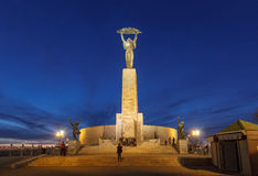 Statue of Liberty at blue hour, Gellert hill, Budapest, Hungary. The Liberty Statue or Freedom Statue (Hungarian: Szabadság Szobor) is a monument on the Gell stock photography