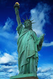 Statue of Liberty with bright blue cloudy sky, New York. New York stock photos