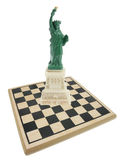 Statue of Liberty and Chess Board Stock Photos