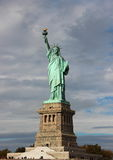 Statue of Liberty with Clouds Vertical Front View Royalty Free Stock Photography