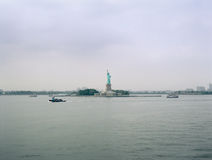 Statue of Liberty on a cloudy day. View from the Staten Island Ferry Stock Image