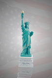 Statue of Liberty on a dark flag of America Royalty Free Stock Photos