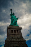 Statue of liberty. With dark ominous clouds stock images