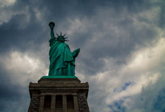 Statue of liberty. With dark ominous clouds royalty free stock photo
