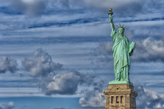 Statue Of Liberty in the deep blue sky Stock Images