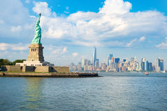 The Statue of Liberty with the downtown Manhattan skyline Stock Photography