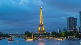 The Statue of Liberty and the Eiffel Tower day to night Timelapse with modern buildings. Paris, France. The Statue of Liberty and the Eiffel Tower day to night stock video