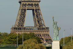 Statue of Liberty and Eiffel tower in Paris France Royalty Free Stock Photography