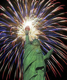 A Statue of Liberty Fourth of July Fireworks Celebration. 4th of July Fireworks, Red, White and Blue, and the Statue of Liberty Royalty Free Stock Image