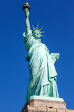 The Statue of Liberty and New York City Stock Image