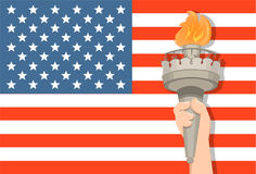Statue of Liberty hand with torch and USA flag on background. July 4th. Independence Day Royalty Free Stock Photos