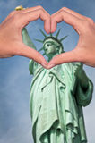 Statue of liberty and hands forming a heart, New York love and travel concept. Statue of liberty and hands forming a heart, New York USA, love and travel concept stock photo