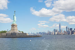 Statue of Liberty island and New York city skyline Royalty Free Stock Photos