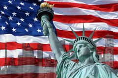 Statue of Liberty on Island in New York with flag. Of the United States of America royalty free stock image