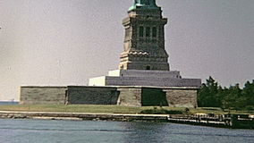 Statue of Liberty Island. Statue of Liberty in Liberty Island panorama from boat tour, Hudson river of Manhattan. New York, United States of America on 1970 stock video footage