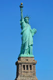 Statue of Liberty. With its base on a blue background in New York City Royalty Free Stock Images