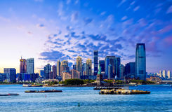 Statue of Liberty and Jersey City in Blue Hour Royalty Free Stock Photos