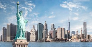 The statue of Liberty, Landmarks of New York City. With Manhattan skyscraper background stock photography