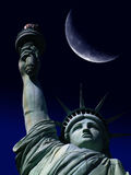 Statue of Liberty with Large Moon Stock Photo